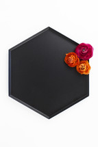 flowers on a black tray