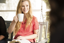 woman drinking coffee at a woman's Bible study