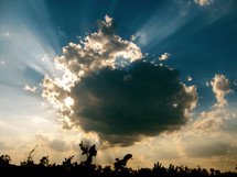 Sky shot with the sun caught behind a dark cloud