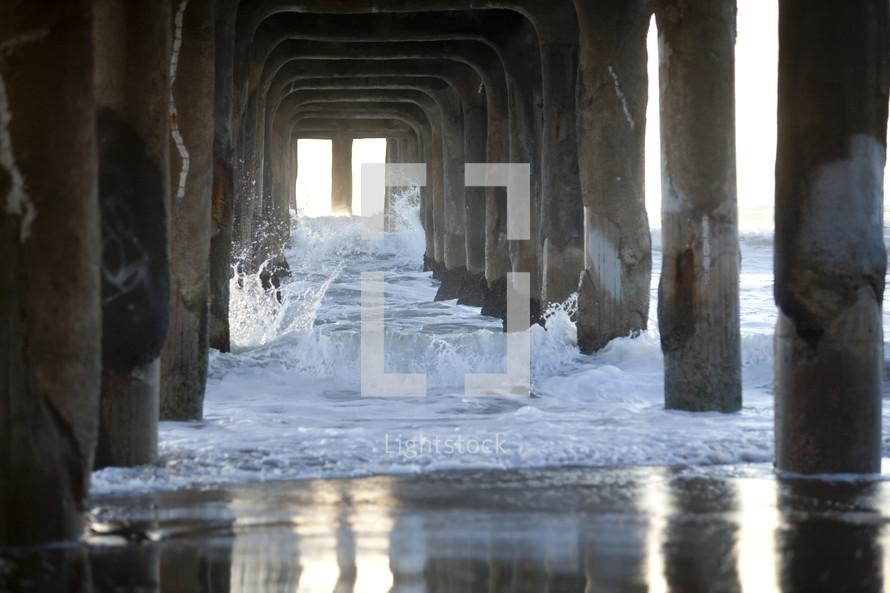 Beach waves under boardwalk