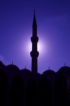 Moonlit minaret at a Muslim mosque.