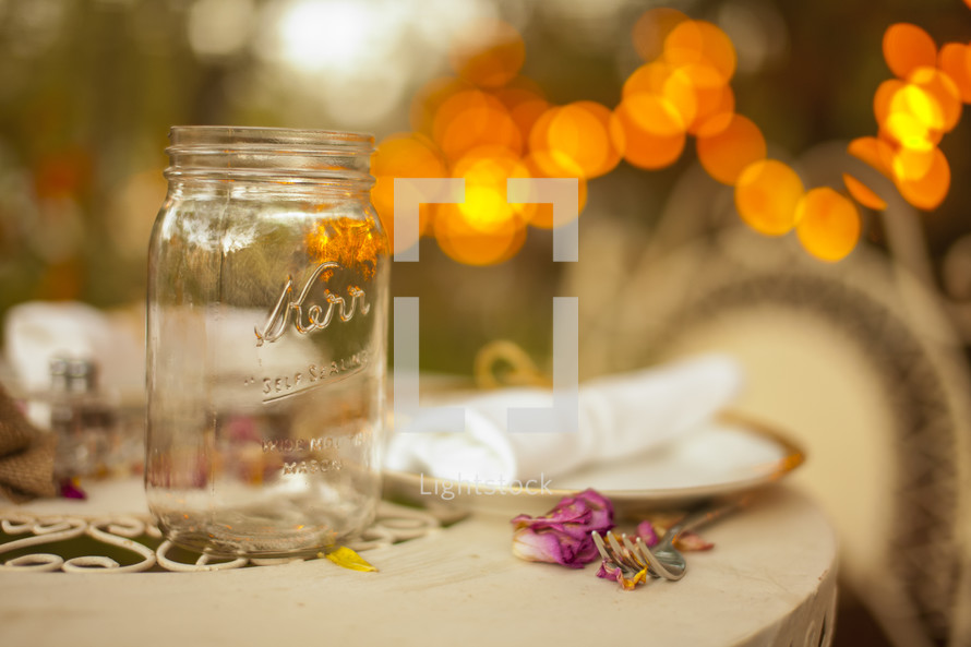 empty mason jar sitting on a table