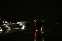 communion wine cup black background