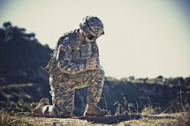 soldier kneeling in prayer