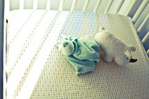 toys in baby crib