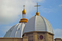 Golden crosses on top of domes on a church