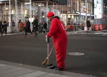 a man sweeping a road