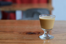 espresso shot on a wood table