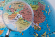 magnifying glass over a globe