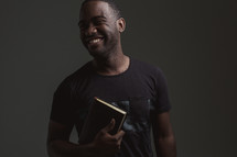 happy man holding a BIble