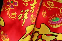 Chinese Lunar New Year print fabric in red and yellow
