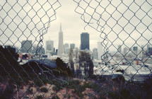 San Francisco through a broken fence