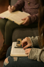 teen girls with Bibles and journals in their laps at a Bible study
