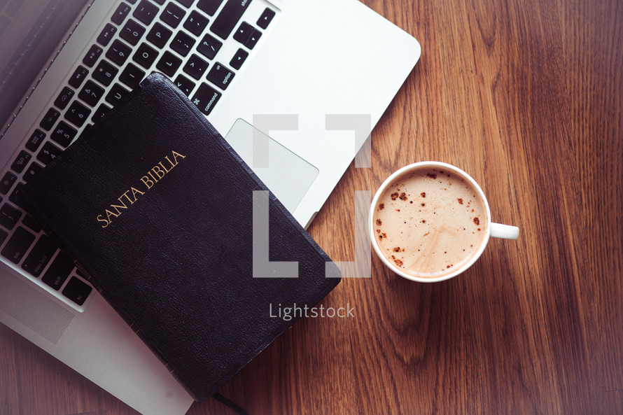 Santa Biblia, laptop, and cappuccino