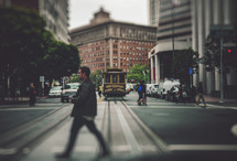 Man crossing street in San Francisco