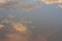 reflection of clouds at sunset on water