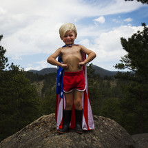 Superhero in an American flag cape