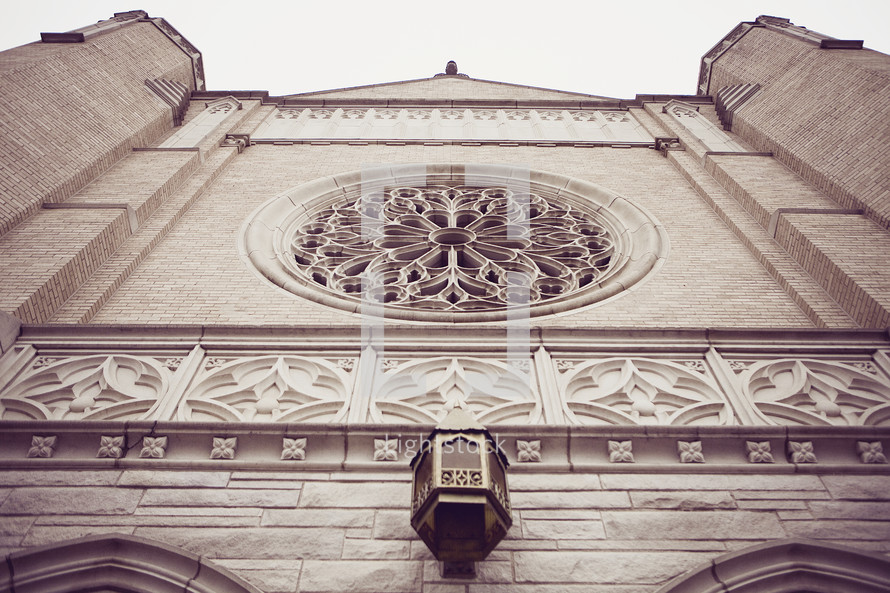 Looking up at an old church