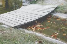 small wooden bridge over a creek