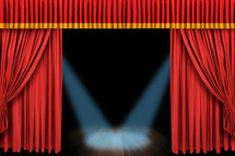 Spotlight on a stage with curtains.