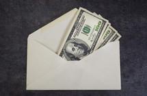 Money Envelope full of hundred dollar bills.
