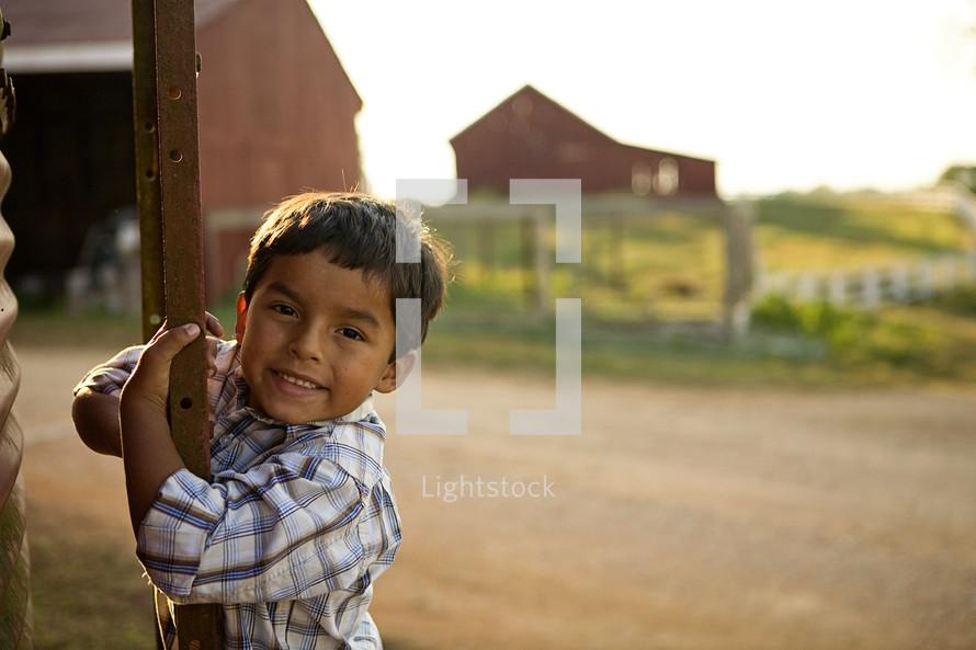 Boy standing on ladder