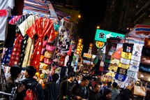People shopping in a street market in Hong Kong, China at night