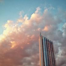 clouds around a sky scraper