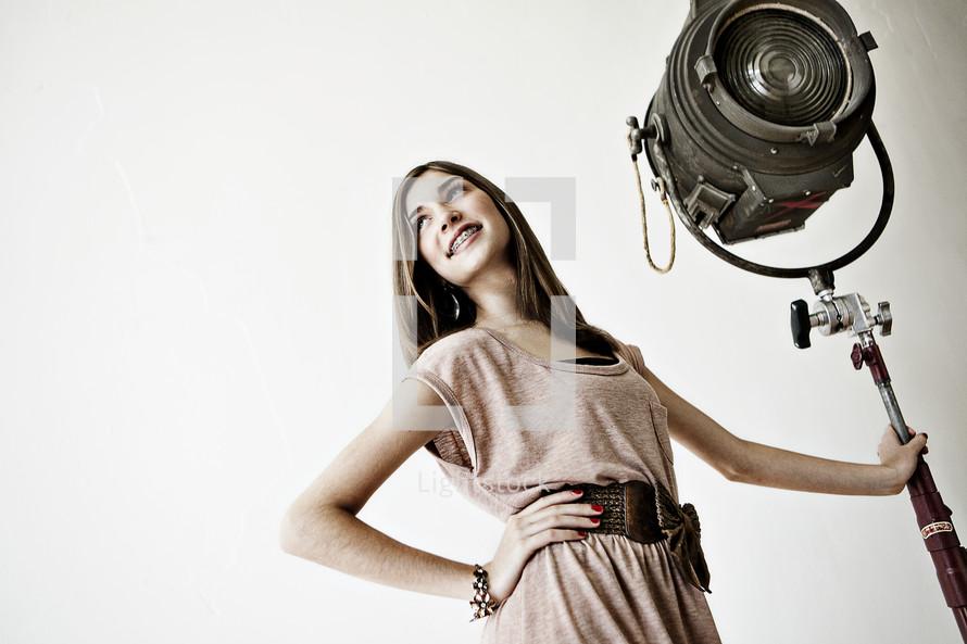 Woman holding spotlight