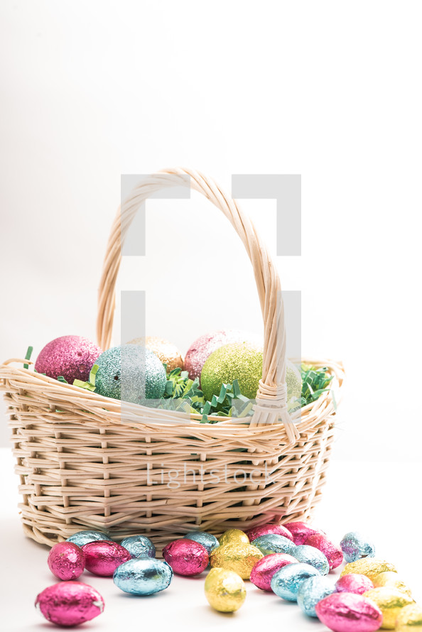 Easter basket with Easter eggs and candy