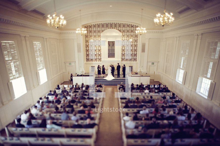 A chapel filled for a wedding ceremony