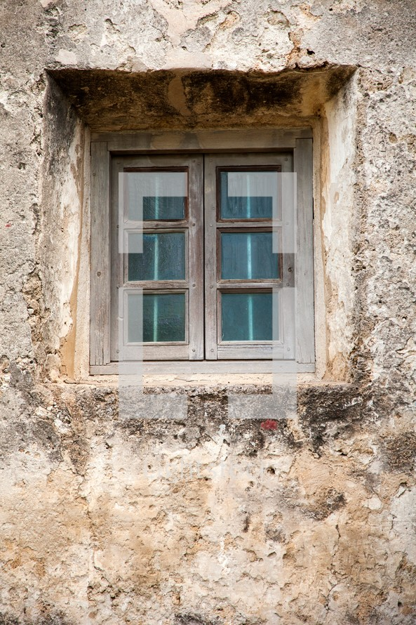 window in old building wall