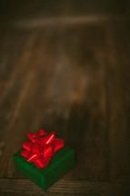 A small Christmas present on a wood table