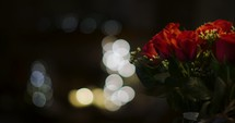bokeh lights and a bouquet of red roses