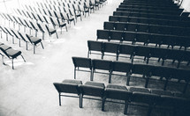 aisle between empty rows of chairs in a church