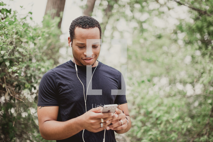a man listening to music on his cellphone