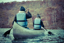 paddling in a canoe