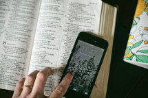 open Bible, journal, and cellphone