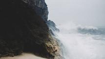 waves crashing into rock