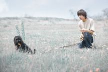 a teen boy and his dog