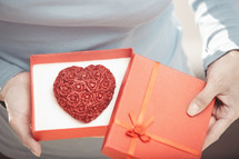 a heart cookie in a red gift box