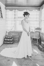 a bride standing in a wedding dress