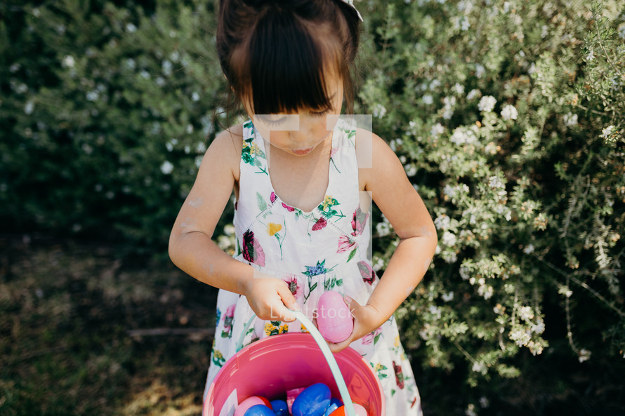 A little girl on an Easter egg hunt