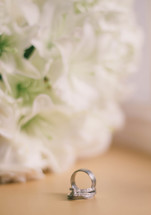 white roses and wedding rings