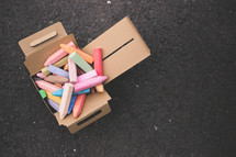 Sidewalk chalk in a box.
