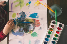 a child painting with watercolors