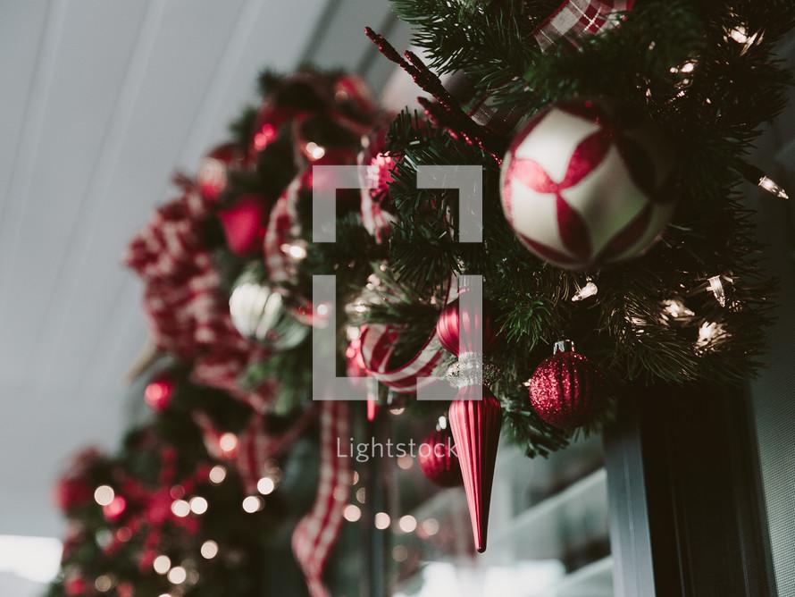 A Christmas garland hung over a window.