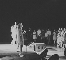woman leading a congregation in song