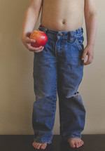 boy child holding a red apple