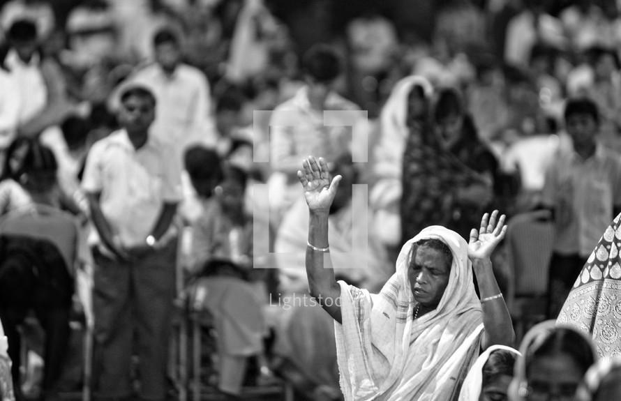 Woman in worship at worship service